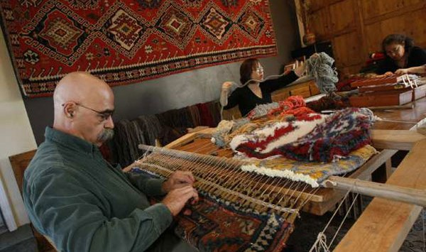 Hratch Kozibeyokian, restorer of rugs, at his home studio in Shadow Hills