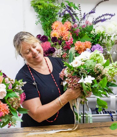 Fiona from Flowersmith Flowers creating a beautiful wedding bouquet in her workshop.