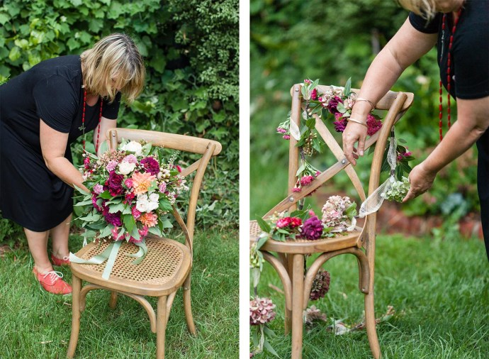Fiona from Flowersmith arranging colourful wedding bouquet and flower garland on chair for styled wedding shoot by Pepperberry Photography.