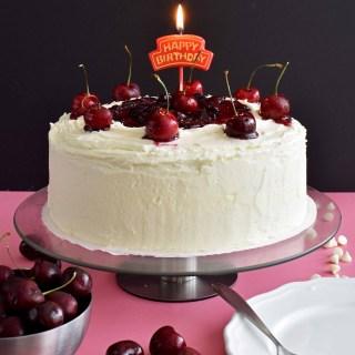 White Chocolate Cake with Cherry Sauce