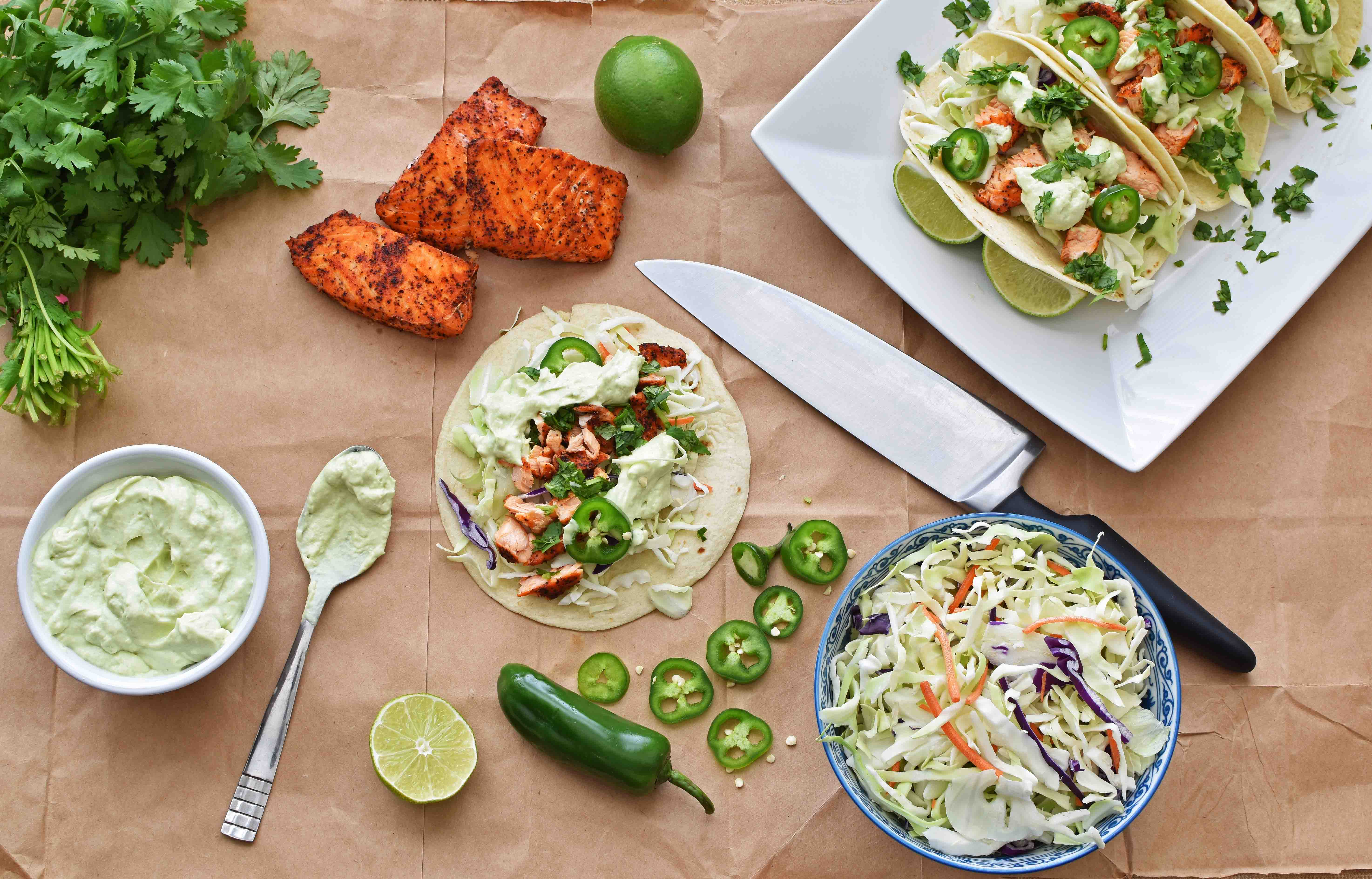 Salmon Taco with Avocado Crema - Pepper Delight #pepperdelightblog #recipe #taco #salmon #fishtaco #tacotuesday #30minuterecipe #avocado