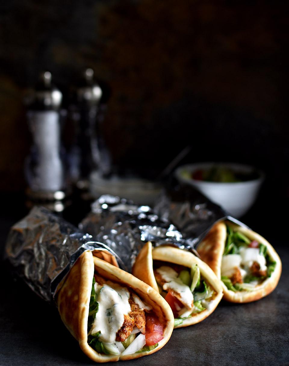 Mediterranean Chicken Pita Wraps with Cilantro Tahini Sauce - Pepper Delight #pepperdelightblog #recipe #chickenpitawraps #wrap #dip #pitawrap #arabic #middleeast #tahinisauce #mediterranean #leftovertahinisauce #celebration #holiday #gameday #yogurtsauce #healthy #quick #greek #gyro