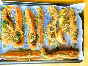 Arrange the herb and parmesan crusted squash on a baking tray