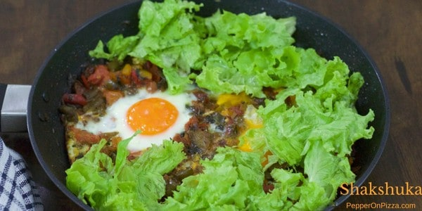 Shakshuka –  Poached Eggs in Peppers & Tomatoes