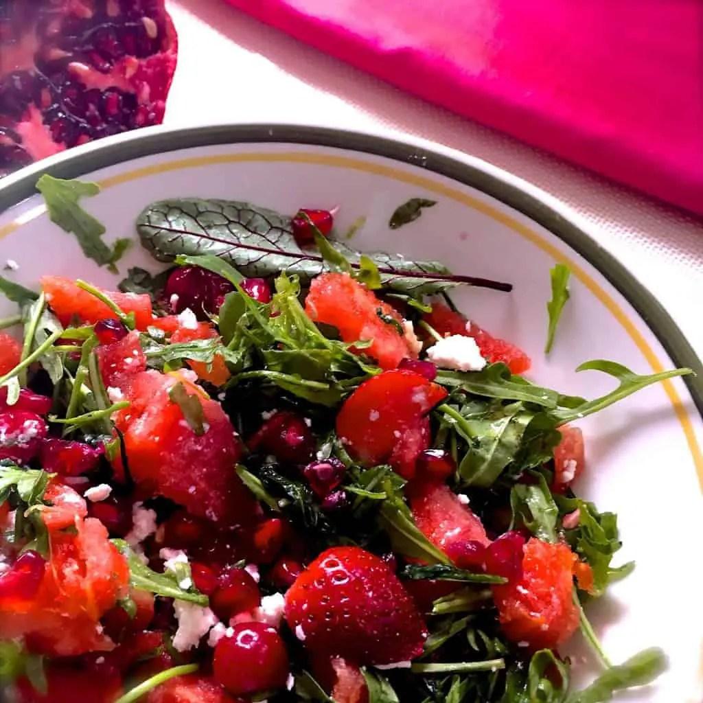 Watermelon Arugula Feta Salad with Strawberries Cranberries and Pomegranate