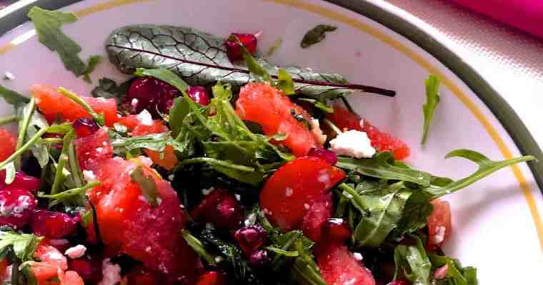Watermelon Arugula Feta Salad with Strawberries Cranberries and Pomegranate