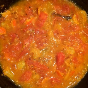 Cook until the tomatoes reach a sauce like consistency