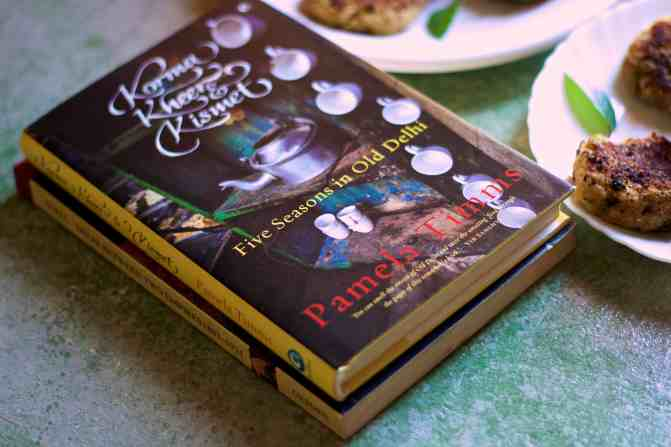A black coloured book with the picture of an aluminium tea kettle and white cups, Pamela Timms book Korma Kheer Kismet