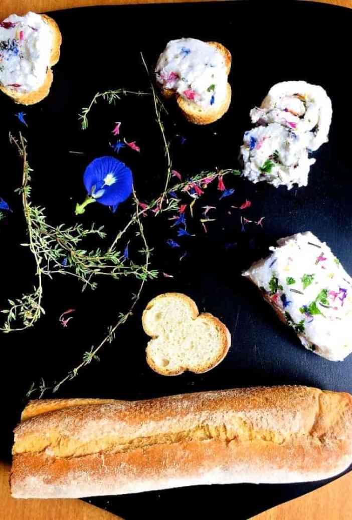 Rolled into a sausage shape and chilled this edible flower and herb butter can be cut into rounds and spread on crostini or bruschetta