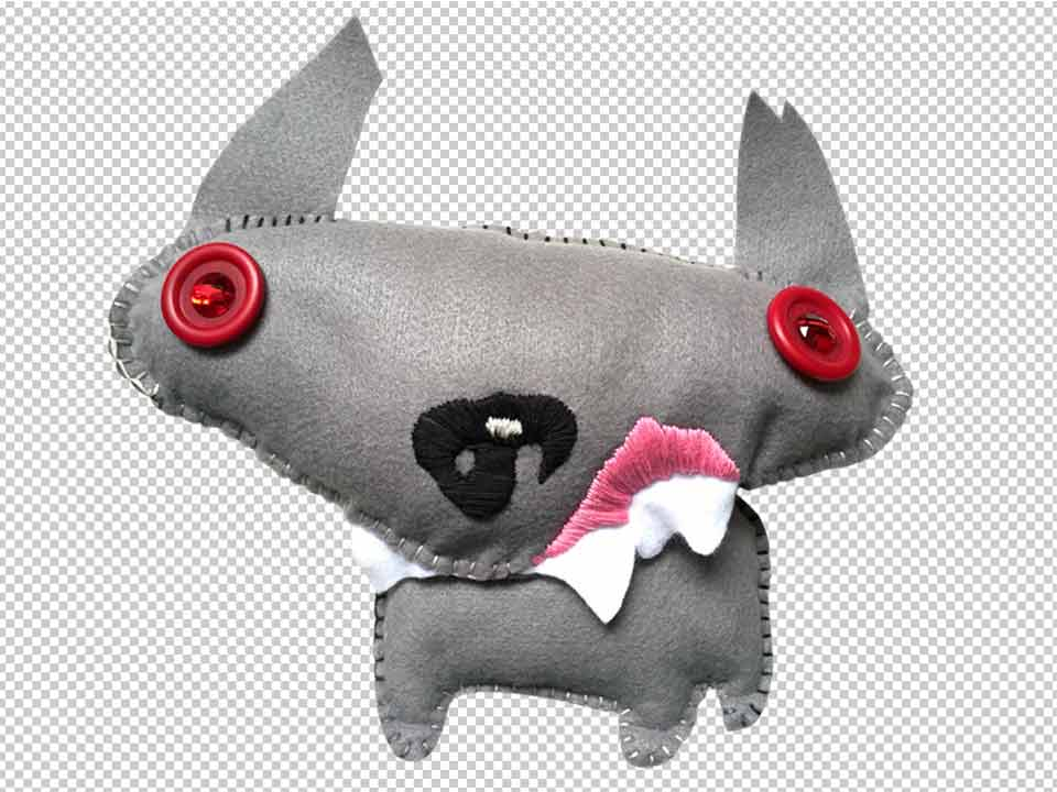 Handmade plush dog extracted from image, now on a transparent background
