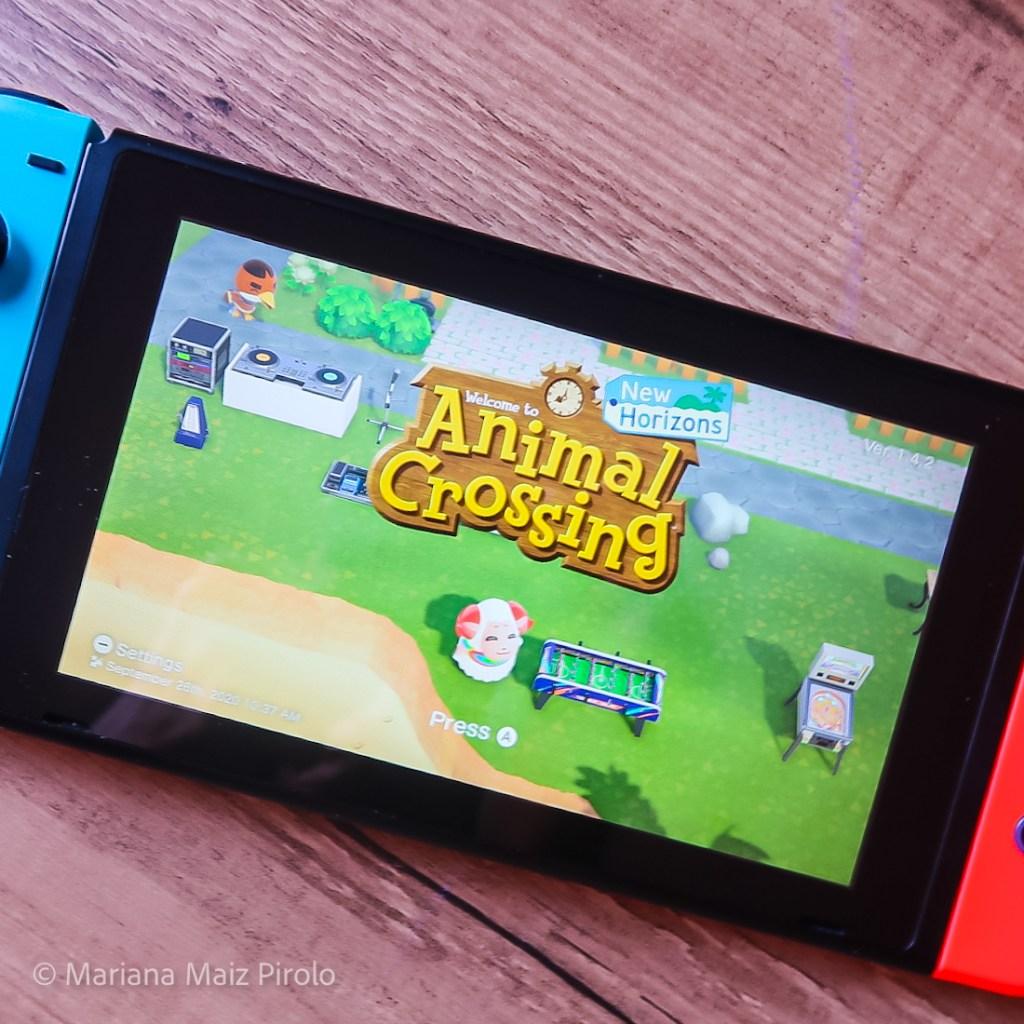 Console Nintendo Switch com a Tela Inicial de Animal Crossing New Horizons