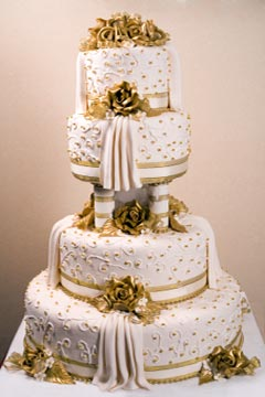 Gold With White Swirls Wedding Cake