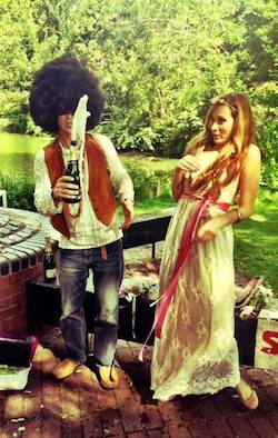 Alastair and Elyse Macartney pop a bottle of Champagne shortly after their costume wedding in Oxford, UK