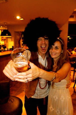 Toasting with beer on our wedding day