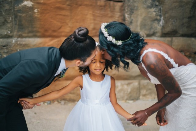 Bride and Groom with Daughter on Wedding Day