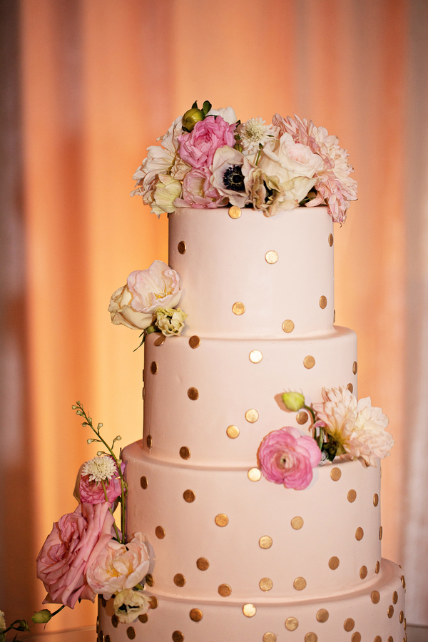 gold polka dot wedding cake with flowers