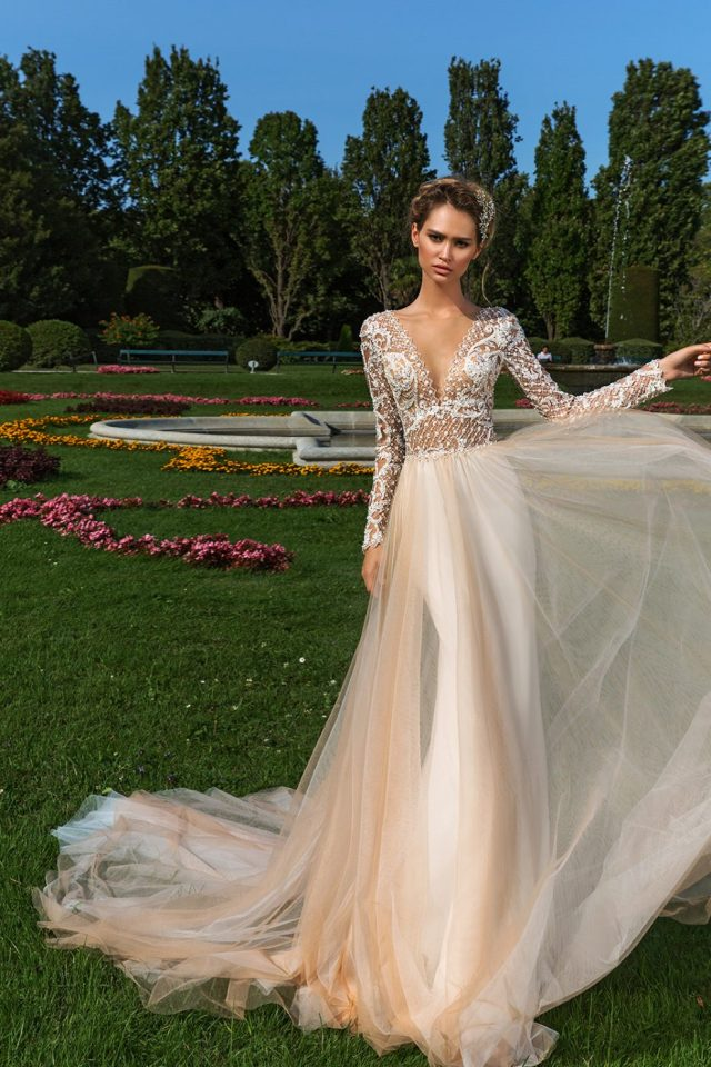 plunge neckline wedding dress by Crystal Design Couture