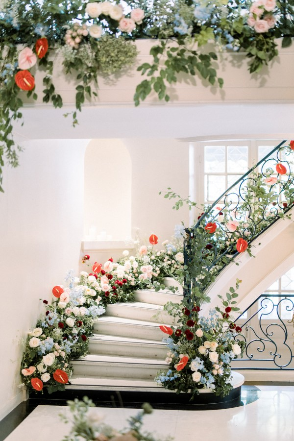 Lush floral wrapped stairway