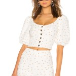 polka dot top with buttons by lpa. sold at revolve. chic summer look in white and tan.