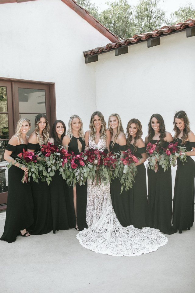 black bridesmaid dresses with red flowers and greenery bouquet