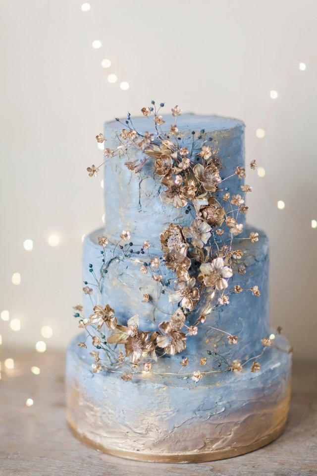 blue spring cake with gold flowers