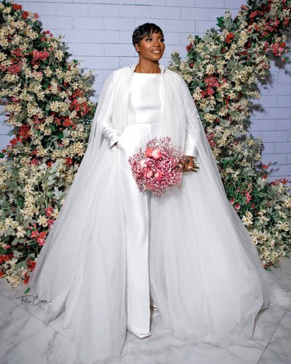 long sleeved white pantsuit with cape train for wedding