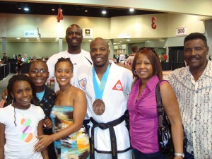 Mr. Validores Poses with Family after Winning 3rd Place Sparring at World Championship
