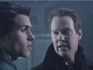 General Xaviax (William O'Leary) explains his evil plans with Drew Lansing (Christopher Foley)