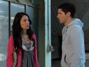 Maya and Chris (Kamen Rider Sting) watch the fight and Chris is conflicted about what he should do.