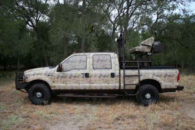 high chair deer stand gym workout youtube performance top drive hunting truck outfitters 4wd this is our bench seat rack on a ford pick up notice the blended camouflage with dark brown bed liner