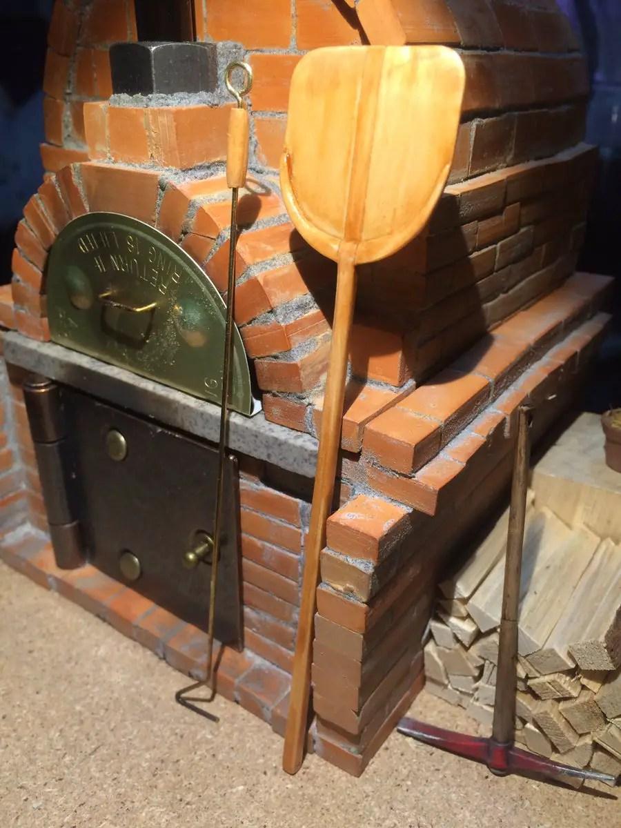 Crean horno a le a en miniatura que hace pizzas de verdad for Pala horno pizza