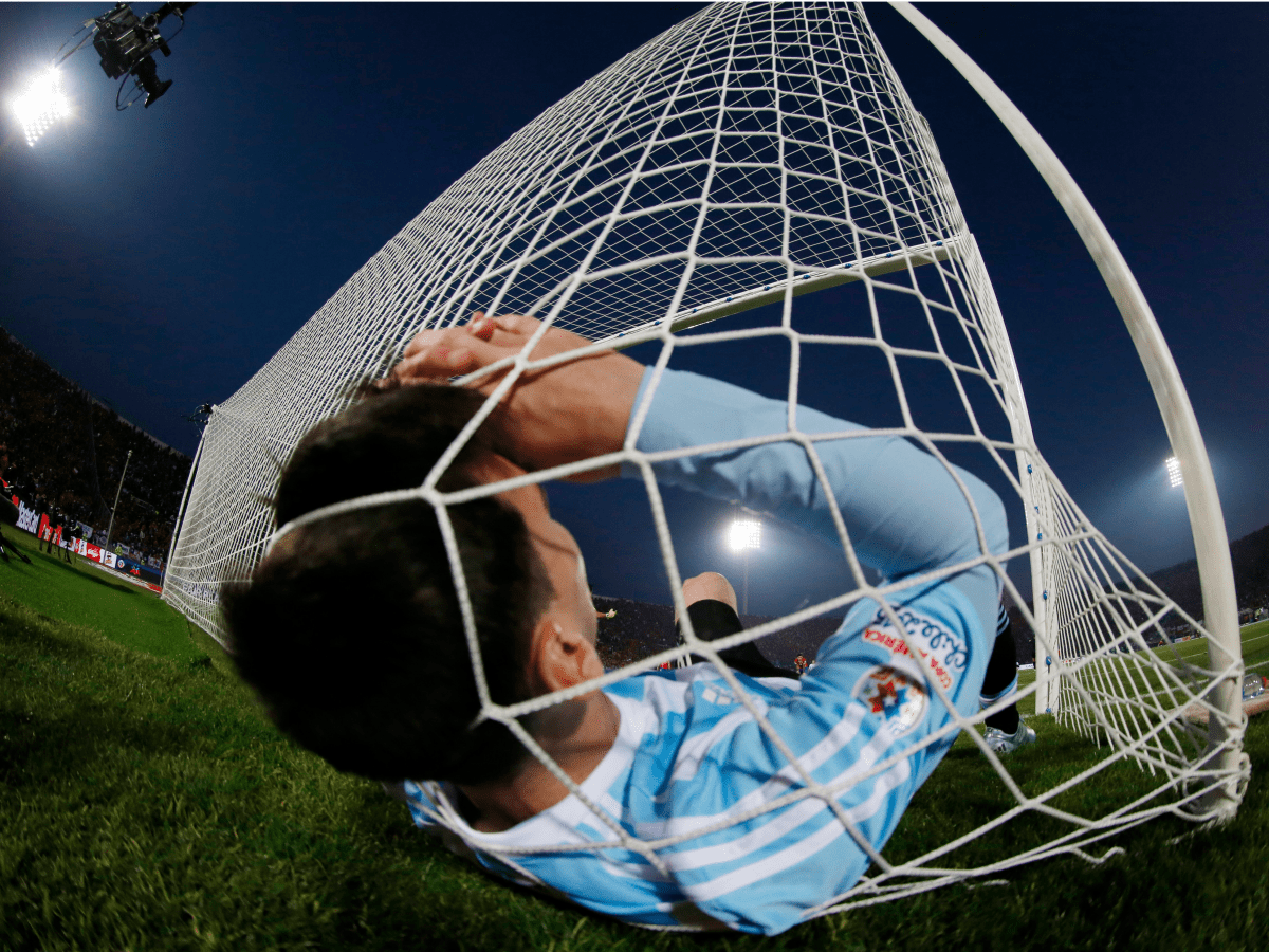 argentinas-lionel-messi-falls-in-the-net-during-the-copa-america-2015-final-soccer-match-against-chile-at-the-national-stadium-in-santiago-chile-july-4-2015