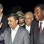 Iranian President Mahmoud Ahmadinejad waves next to Benin's President Thomas Boni Yayi as he arrives in Cotonou -0OMP2871.jpg-