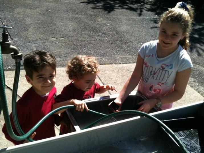 Children washing the tube pots ready for planting