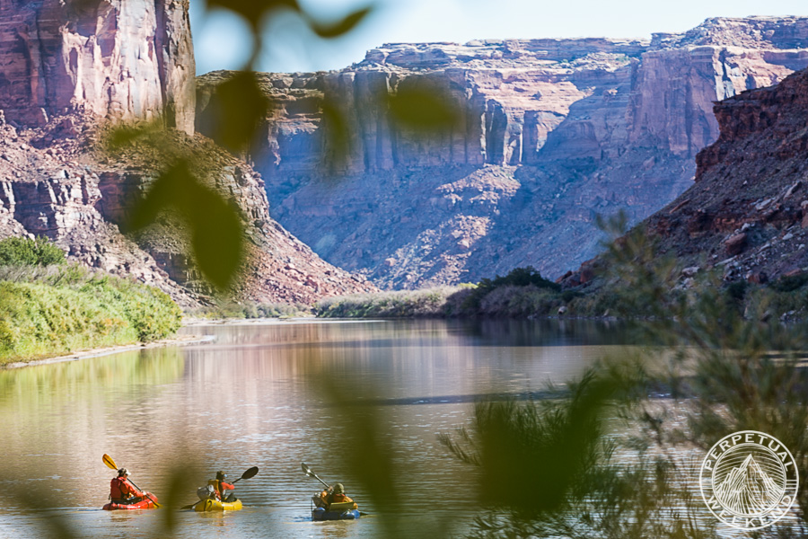 Chris Solomon, Forrest McCarthy, and Scott Schell paddle the Green River, Utah