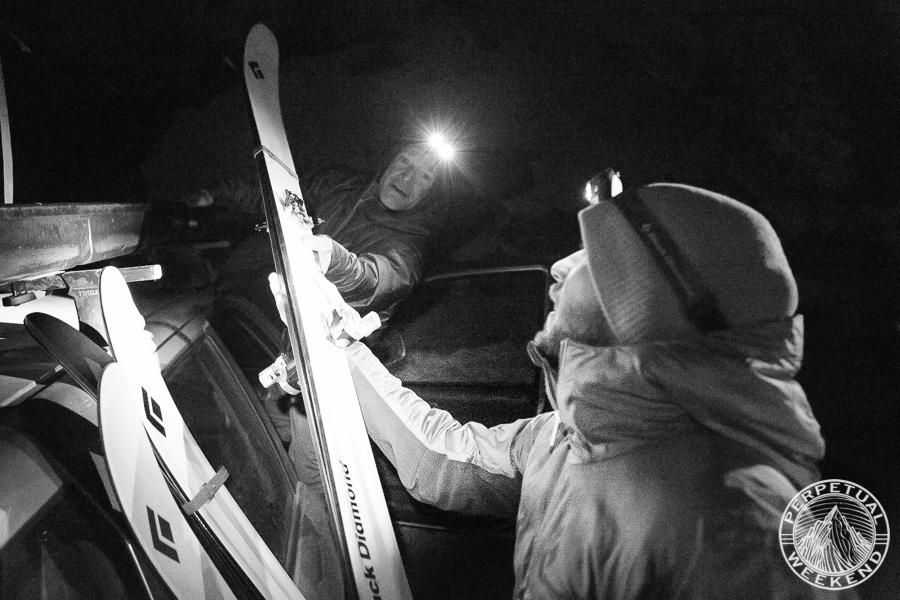 Jon Coppi and Mike Elggren unload skis