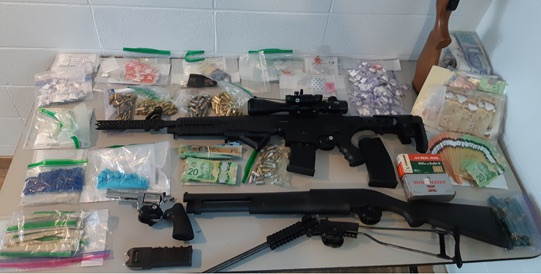 SEIZED GUNS DRUGS AND AMMO