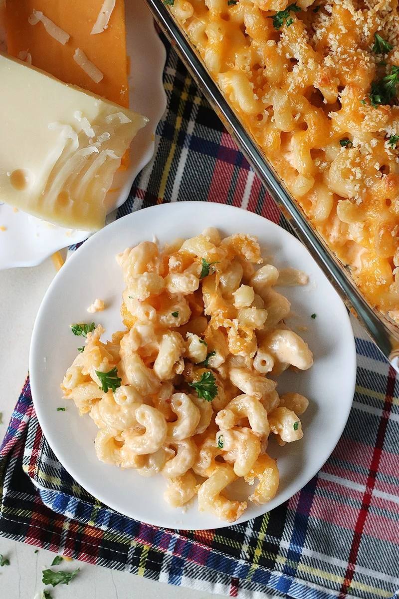 Homemade Baked Macaroni and Cheese is a delicious, super rich, five cheese baked mac and cheese recipe. This copycat steakhouse recipe is fancy enough to serve to guests for holidays, but so delicious, you'll want to make this easy baked mac and cheese recipe every day! | www.persnicketyplates.com
