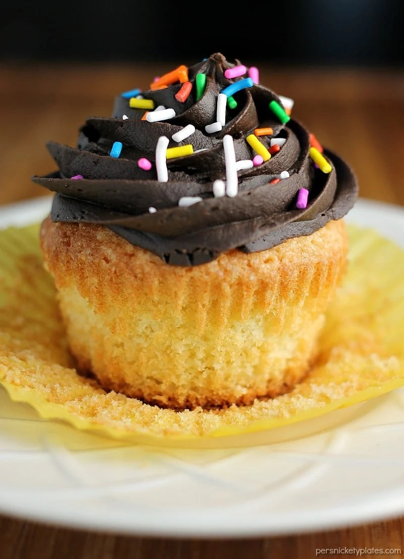 Vanilla Cupcakes made from scratch should be a staple recipe in every bakers' arsenal. This recipe makes a small batch perfect to satisfy a craving. | www.persnicketyplates.com