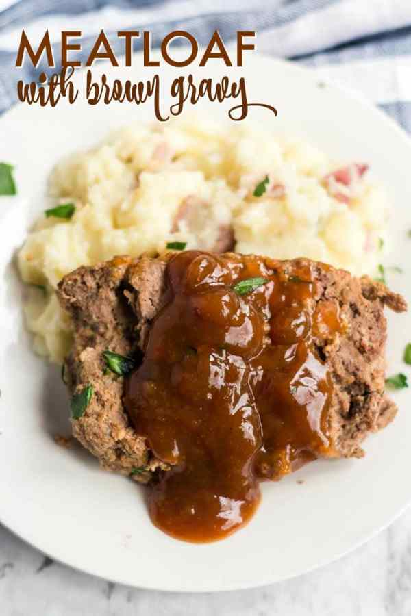 slice of meatloaf with brown gravy spooned over on mashed potatoes