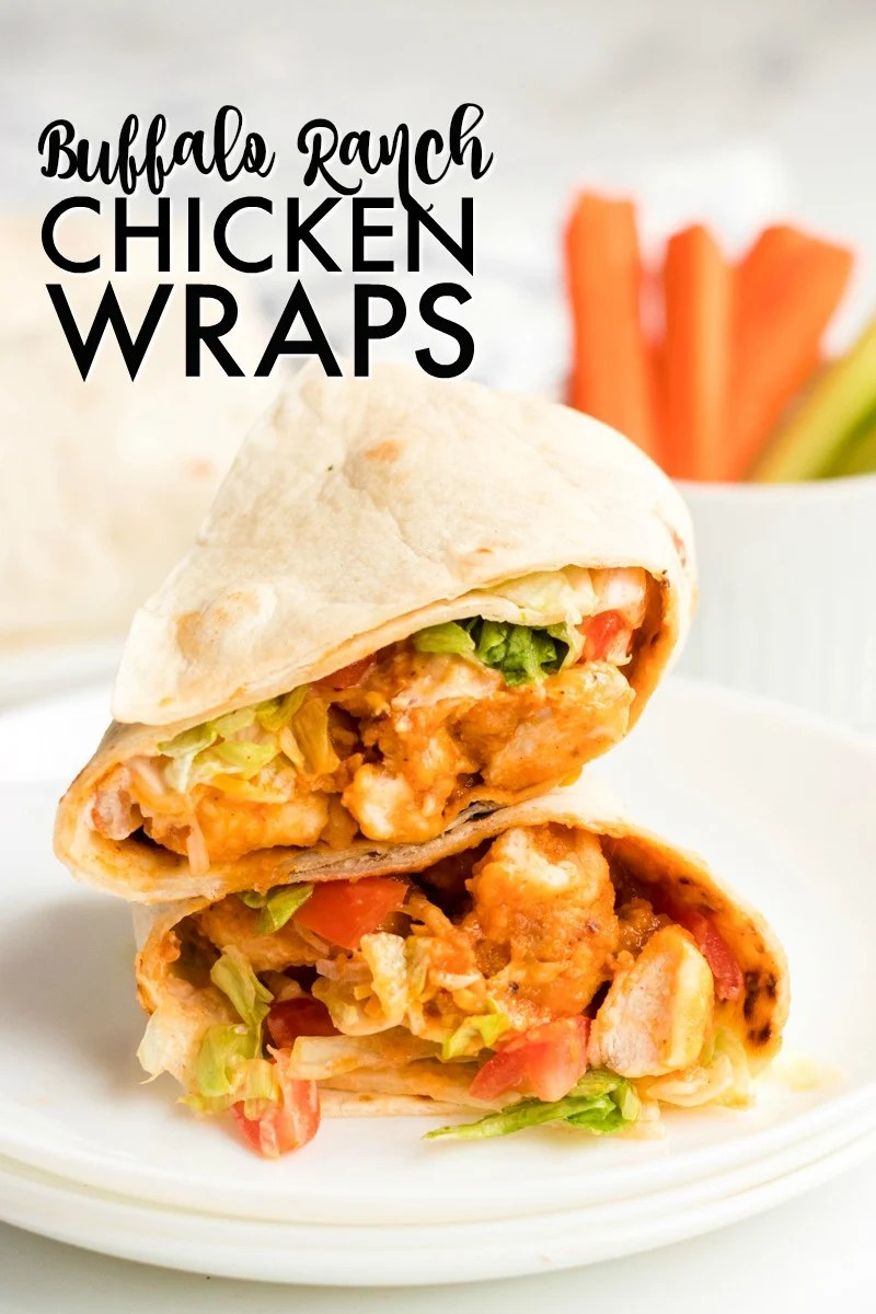 If you like the Buffalo Ranch Chicken Wrap from Buffalo Wild Wings, you'll love this lightened up homemade version! Lightly breaded buffalo chicken pieces wrapped up in a soft tortilla with ranch dressing, shredded lettuce, cheese, and tomatoes make a great dinner or the perfect game day meal! | www.persnicketyplates.com
