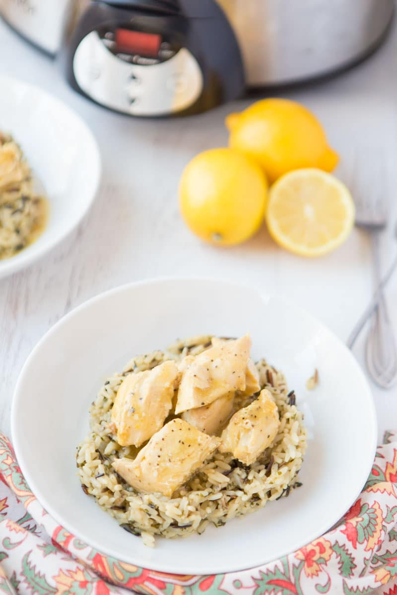 lemon chicken on wild rice with slow cooker & lemons in background