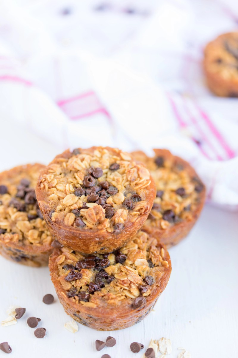 stack of 4 Baked Oatmeal Breakfast Cups surrounded by mini chocolate chips