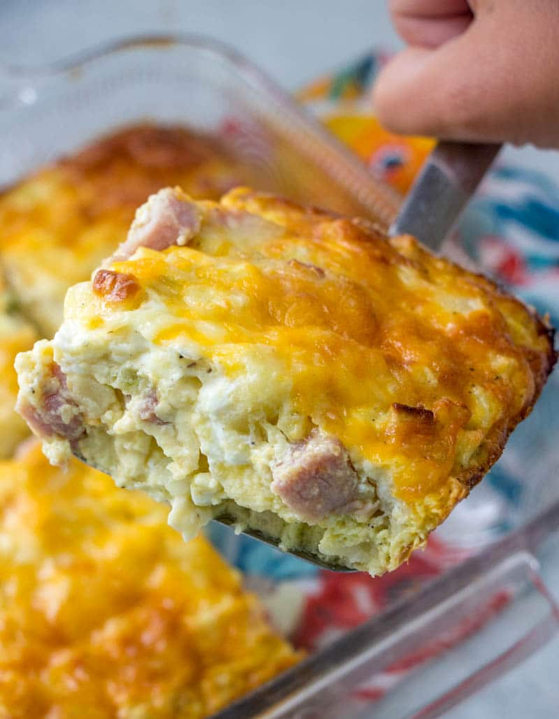 serving of ham & potato breakfast casserole over a baking dish