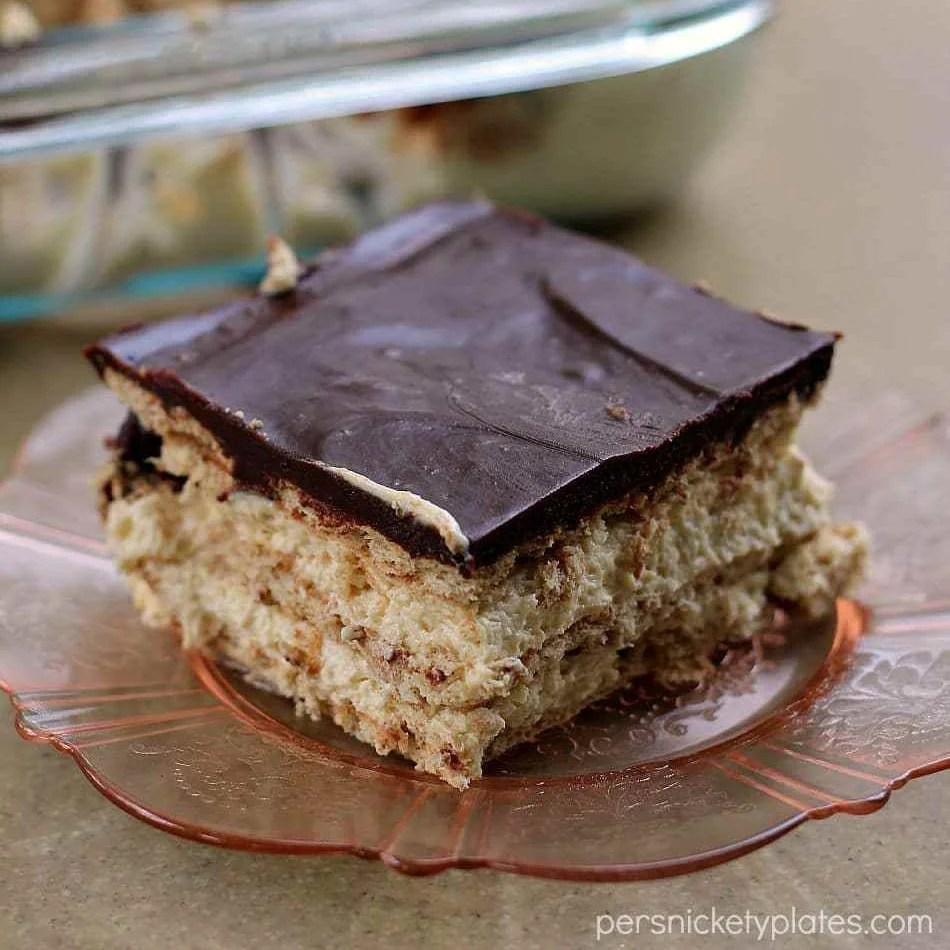 slice of chocolate peanut butter eclair dessert on pink plate