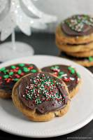 A brown butter chocolate chip cookie slathered with a layer of salted caramel then topped with chocolate and sprinkles. | Persnickety Plates