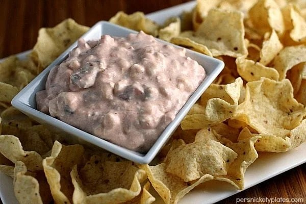 platter of tortilla chips with two ingredient creamy salsa dip in center