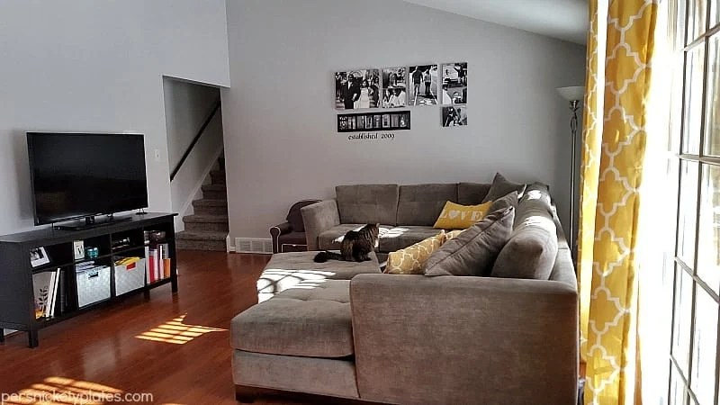 Before and after pictures of our living room/dining room done on a budget. Changing paint makes a huge difference - with Benjamin Moore Stonington Gray & Timber Wolf | Persnickety Plates
