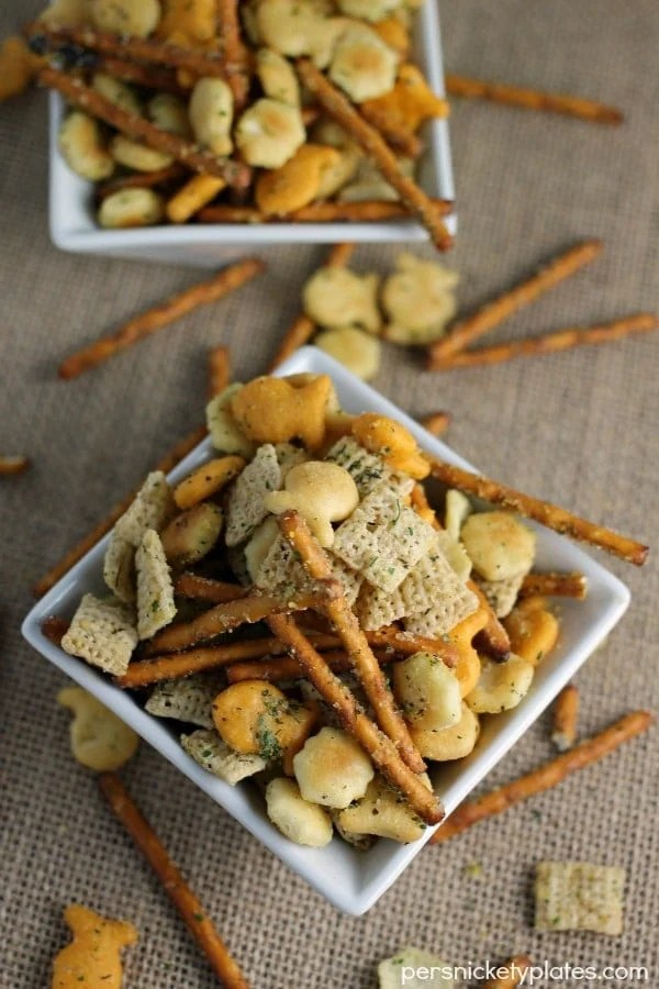 Ranch Cocktail Party Crackers - a blend of ranch flavored pretzels, goldfish, chex, oyster crackers, etc. Mix it up to include your favorites & it's perfect to munch on at parties!   Persnickety Plates