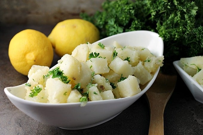 Super simple Arabic Potato Salad only has a few ingredients - potatoes, lemon, oil, garlic, and parsley – but is full of flavor and because there is no mayonnaise, it's great for a picnic!   Persnickety Plates